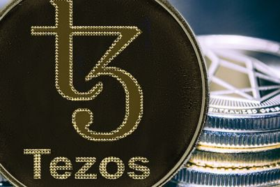 01_Tezos-on-the-background-of-a-stack-of-coins.jpg