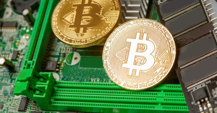 03_Bitcoin-on-computer-circuit-board.jpg
