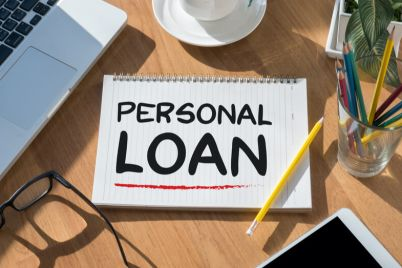 03_Personal-loan-open-book-and-a-computer.jpg