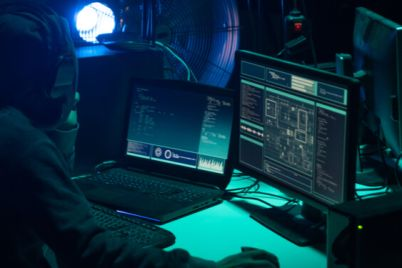 05_An-image-of-a-hacker-working-on-multiple-screens.jpg