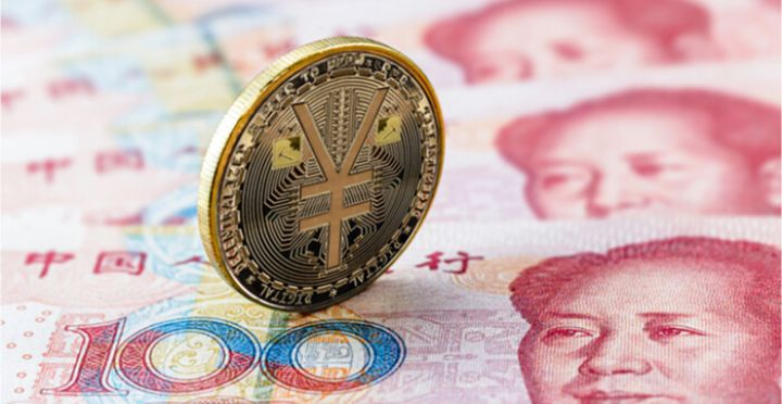 05_An-image-of-an-e-RMB-gold-coin-on-top-of-yuan-notes.jpg